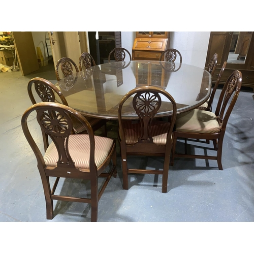 111 - A oval mahogany glass top board room table and ten chairs