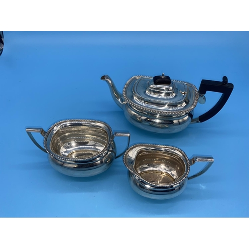 185 - A hallmarked silver three piece tea set compromising of teapot, milk/cream jug and sugar bowl. Hallm...