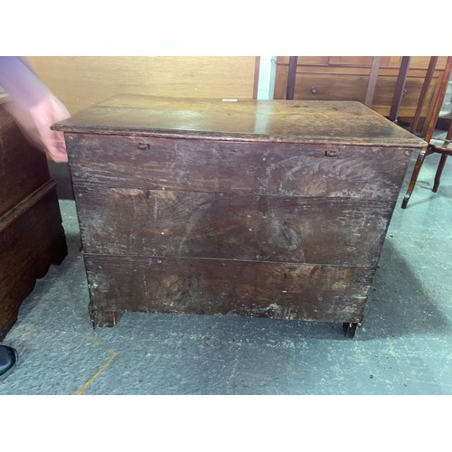 130 - A 19th century oak Coffer-bach having planked top over two panels with single drawer. 25.5 Inches Lo...
