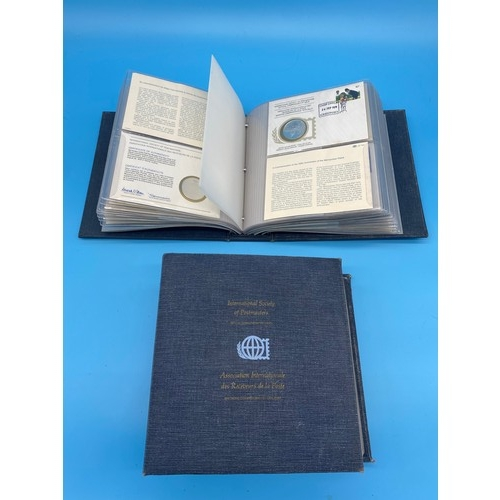 192 - Two collectors albums containing sixty medallic first day covers - 'The international Society of Pos...