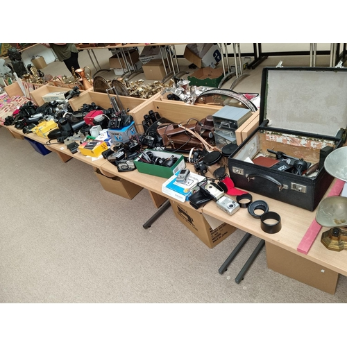 29 - A large collection of cameras and lenses, tripods, binoculars etc including Zenomatic Super 8 , Cano...