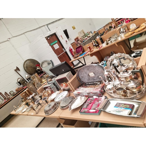 33 - A large collection of silver plated items including coffee and tea pots, sugar/jug and trays, epergn...