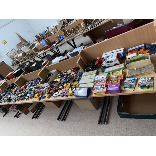 24 - A large collection of playworn Diecast cars
