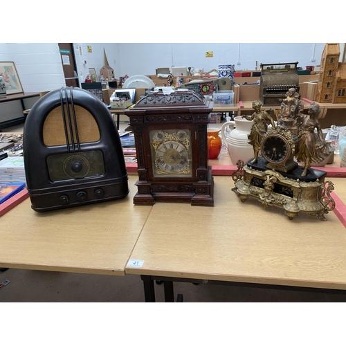 41 - A brass mantle clock, oak mantle clock and a Philco Bakelite radio