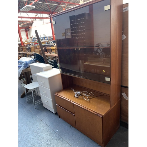 545 - A teak wall unit, bedside cabinet, stool and a bookcase