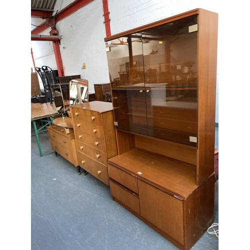 527 - A retro chest of drawers and matching dressing table and a teak display cabinet