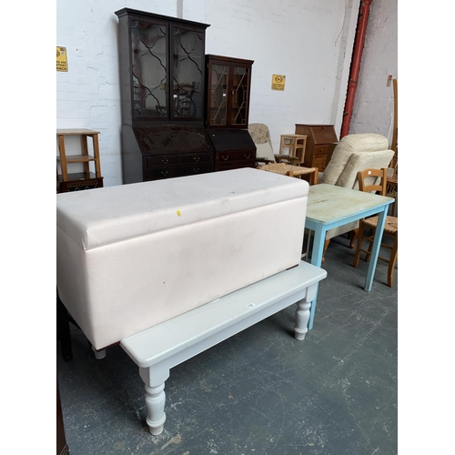535 - A large ottoman, painted coffee table and a dining table