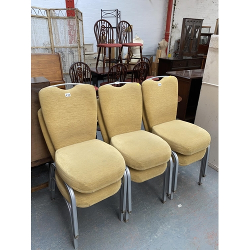 556 - Six metal frame stacking chairs
