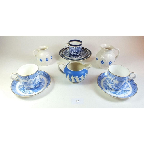 26 - A Coalport trio, two Worcester blue and white coffee cups and saucers and three small decorative jug...