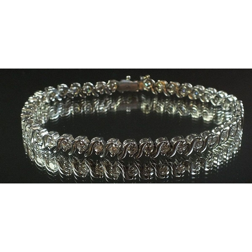 A white gold diamond set tennis bracelet, 18.2cm, 17.8g (total diamond weight 4 ct)