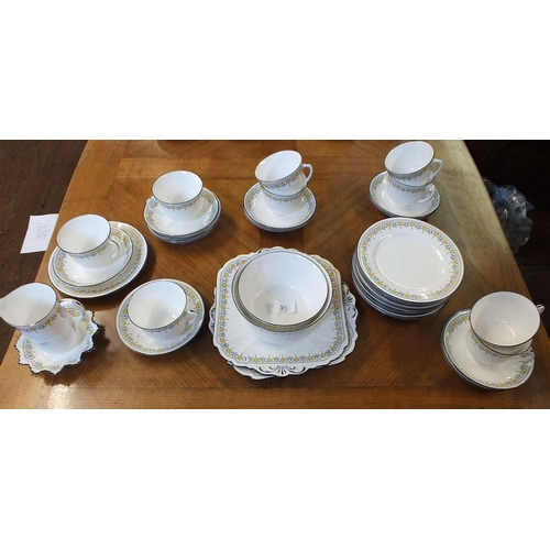 35 - A 1920's Shelley Porcelain tea set in the Bell pattern (no. 11233), comprising  9 trios, 2 cake plat...