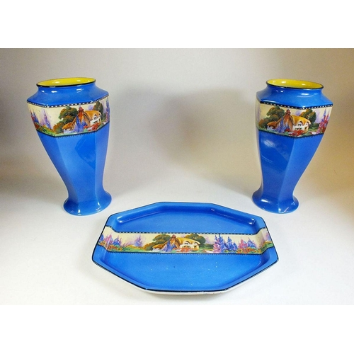 37 - A pair of H & K Tunstall blue vases and dressing table tray printed garden scenes...