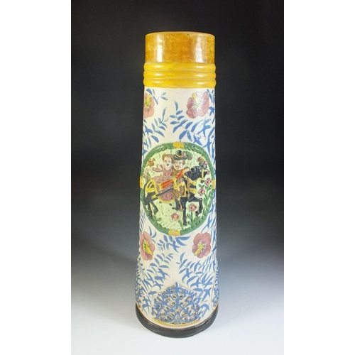 44 - A continental tall jug decorated with couple on a horse on a floral ground...