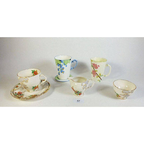 57 - A Royal Cauldon floral trio with milk and sugar plus a Foley floral painted mug retailed by Lawleys ...