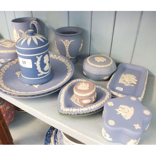 59 - A collection of thirteen items of blue Wedgwood Jasperware...