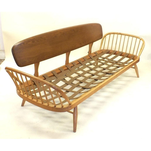 1162 - A retro Ercol elm and beech three seater day bed