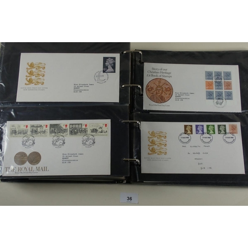 36 - Some 200 GB QEII FDC 1964 to 1998 in album and shoe box, many purposed/Philatelic Bureau, with some ...