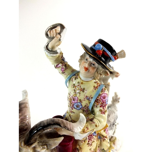 526 - A late 19th century Meissen porcelain group, Count Bruhls Tailor, some minor damage...