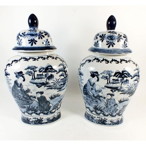 1 - A pair of Chinese blue and white vases and covers, painted figures and landscapes, 38cm