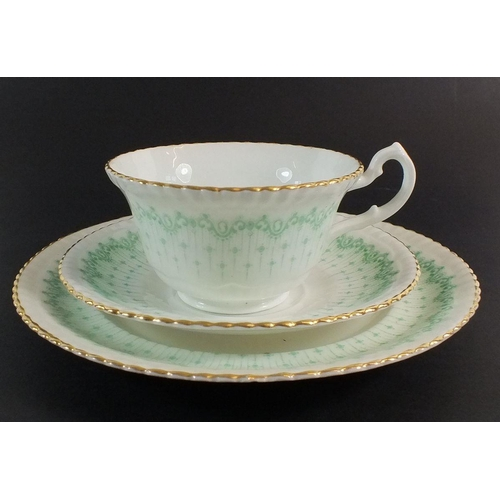 11 - An early 20th century green printed tea service, to include 9 cups, 10 saucers, 10 tea plates, 3 san...