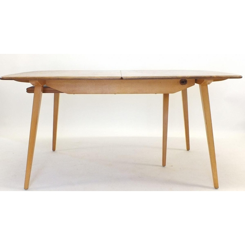1153 - An Ercol elm Windsor extending dining table (89 x 153cm at smallest size with two interleaves at 35c...