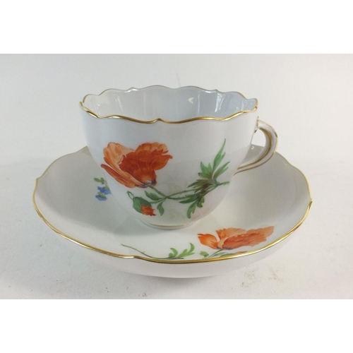 12 - A 20th century Meissen tea service comprising  eleven cups and saucers painted sprays and posies of ...