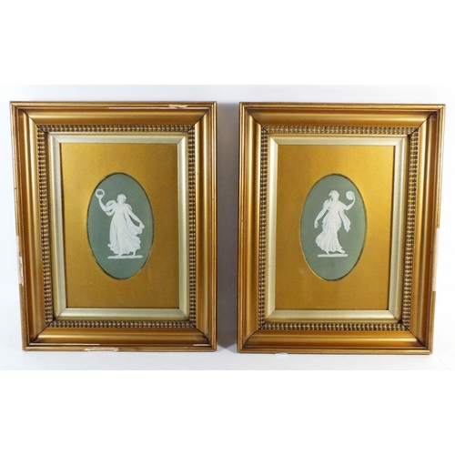 13 - A pair of late Victorian Wedgwood Jasperware green oval plaques of muses, framed and glazed, impress...