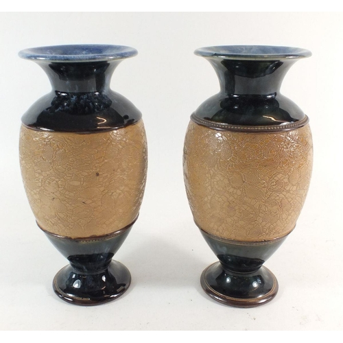 23 - A pair of Royal Doulton stoneware vases, 20cm, one chipped