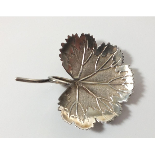252 - A silver leaf form caddy spoon with tendril handle, Birmingham  1807 by Matthew Linwood...