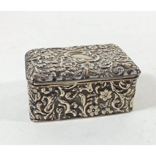 293 - A silver embossed stamp box, Birmingham 1903, 7cm wide by Cohen & Charles...