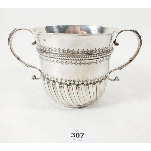 307 - A large silver porringer or caudle cup, London 1706 by John Abbott, with embossed decoration, 345gms...