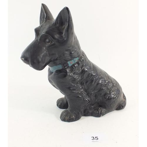 35 - A Sylvac black pottery dog, 19.5cm