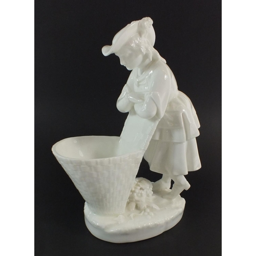 46 - A Minton white glazed posy vase in the form of grape picker resting on her basket, 22cm