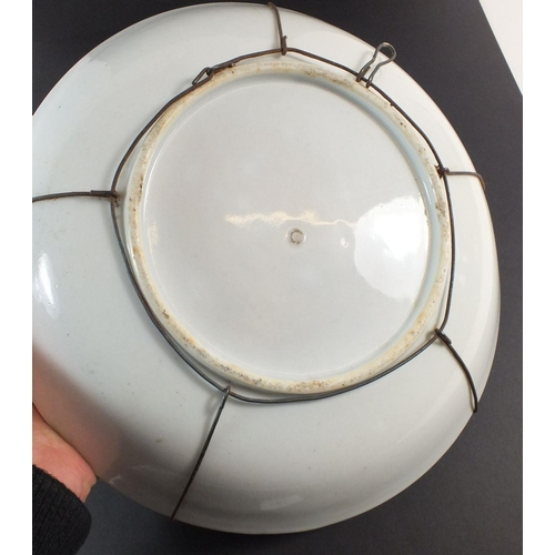 51 - A Chinese 'Famille Verte' dish with hanging wire, 28cm diameter