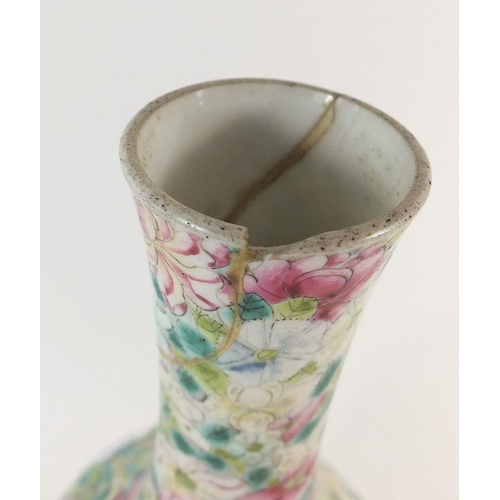 56 - A 19th century Chinese famille rose porcelain vase decorated with flowers, 24.5cm, a/f