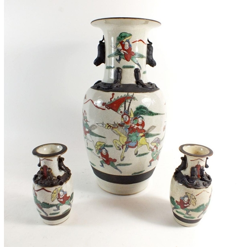 59 - A Chinese pottery vase painted warriors on a crackle ground, 35cm and two similar smaller vases