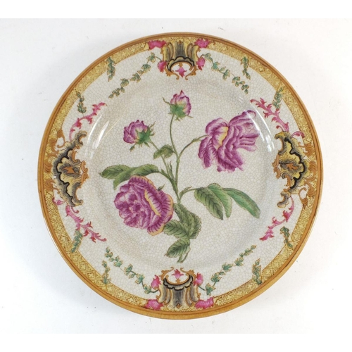 60 - A European crackle glaze pottery plate decorated with flowers, 26cm diameter