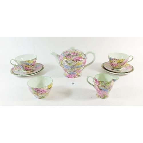65 - A Shelley Chintz 'Rock Garden' bachelor tea service comprising: teapot, two cups and saucers, milk a...