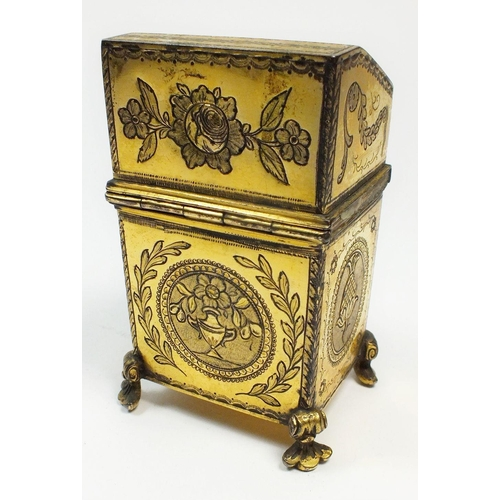 871 - A 19th century French brass etui in the form of a slope top desk, the engraved exterior set line of ...