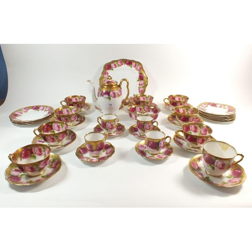 11 - A Royal Albert early 20thC part tea and coffee set comprising: coffee pot a/f , nine cups and saucer...