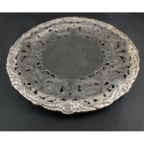 159 - A fine Walker & Hall silver salver or cake stand with deep pierced and chased floral and foliage bor...