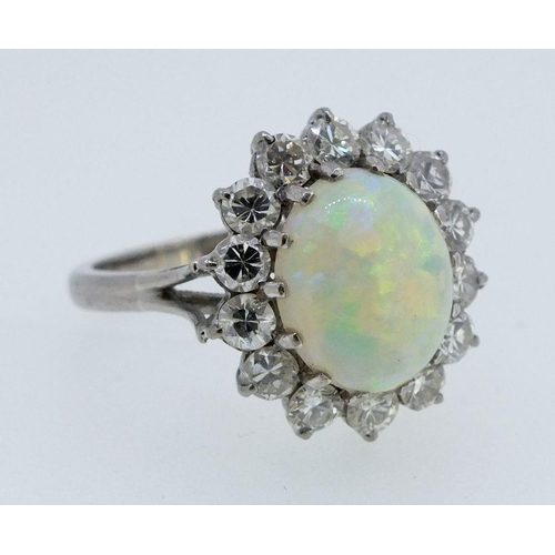 218 - An 18ct white gold Australian opal and diamond cluster ring, size M, 4.3g...
