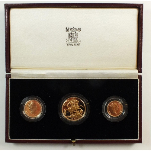 313 - A gold proof set 1987 with sovereign, half sovereign and two pound coin No. 01274, all cased with ce...