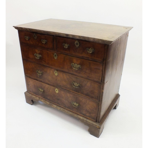 662 - A George II walnut chest of two short and three long drawers with herringbone inlay and crossbanding...