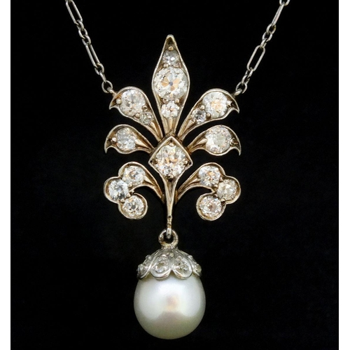 783 - An Edwardian yellow and white gold pendant set diamonds with pearl drop, on white metal chain, 80g -...