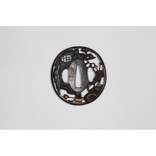 11 - Japanese sukashi tsuba, tea making utensil and landscape, 19th century Title: Sukashi tsuba, tea mak...