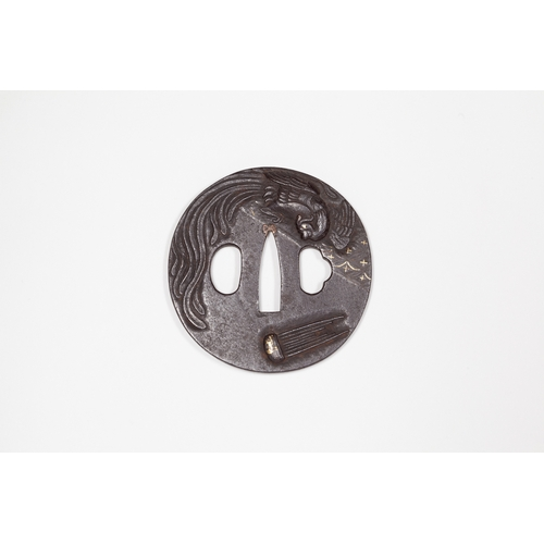 14 - Japanese phoenix and sho designed tsuba, 19th century Title: Phoenix and sho (Japanese traditional c...