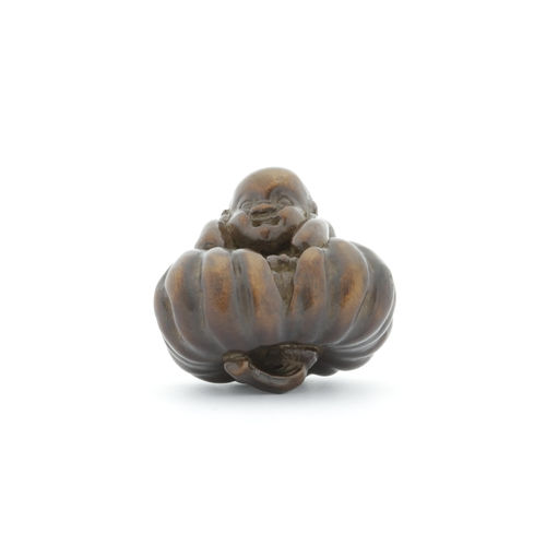 30 - Japanese wooden netsuke of a boy sitting on the pumpkin, 19th century, Title: Wooden netsuke of a bo...