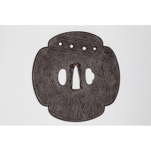 9 - Japanese mokko tsuba, 19th century Title: Mokko tsubaDate: 19th centurySize: 11.2 x 10.9 x 0.4 cm...