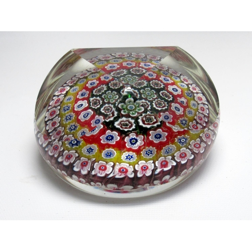 98 - A GLASS MILLEFIORE CIRCULAR PAPERWEIGHT WITH FACETED DOME (DIA. 8.5 CM) CAITHNESS SWIRL AND BUBBLE G...